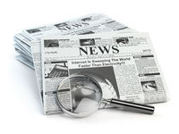 News. Loupe with  periodic ho news newspapers isolated on white.