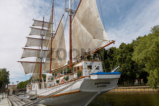 Beautiful white yacht Meridianas- famous symbol of old town of Klaipeda Lithuania
