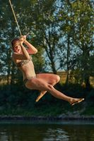 Rope swing river jump