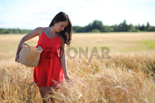 Summer landscape and a girl on nature walk in the countryside.