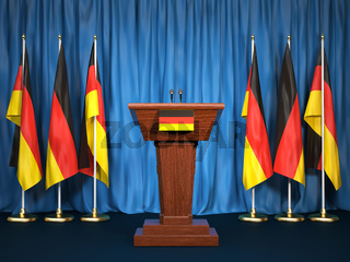 Podium speaker tribune with Germany flags. Briefing of president or chancellor. Politics concept.