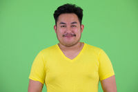Face of young handsome overweight Asian man