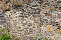 Stones background and texture of medieval castle wall