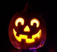 Jack-O-Lantern Pumpkin Glowing at the Dark in Halloween Season.