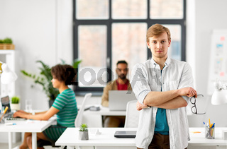 man with glasses at office