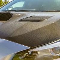Carbon fiber hood and tallight of a silver car