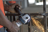 Person doing welding work, India.