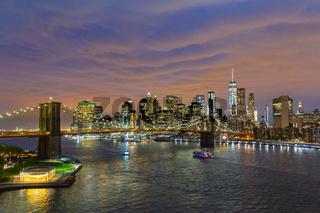 Brooklyn Bridge and Lower Manhattan skyline at night, New York city, USA.