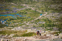 July 26, 2019. Norway tourist route on the trolltunga. People tourists go hiking in the mountains of Norway in fine sunny weather to thetrolltunga. Hiking backpack theme