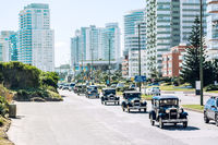 Participants of the winter parade of vintage cars entering the city of Punta del Este, Maldonado, Uruguay