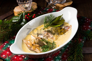 fried christmas carp in butter sauce with dill and lemon