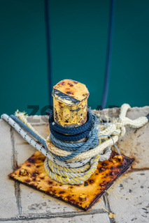 Ropes tied to the small steel anchoring bollard