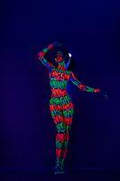 Dancing girl with UV bodyart full-length shot