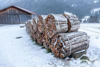 Firewood near a barn