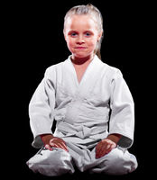 Child martial arts fighter isolated