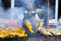 PUNE, MAHARASHTRA, February 2019, Man barbequing chicken at street corner