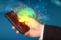 Hand using phone  with worldwide reports links and statistics concept