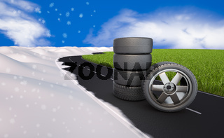 tires on the road next grass and snow