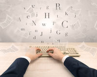 Elegant businessman hand typing with fluttering papers around