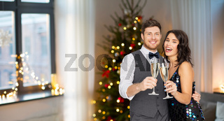 happy couple with champagne glasses at party