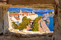 Town of Trogir waterfront and landmarks panoramic view through stone window