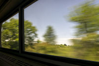 blurred abstract landscape from train window