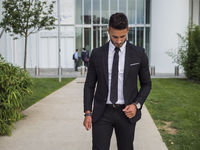 Stylish handsome young man wearing business suit