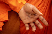 Phone number on hand of Buddhist monk