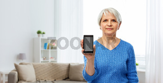 senior woman showing smartphone