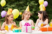 happy girls on birthday party at summer garden