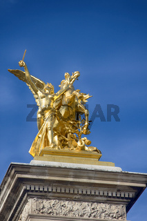 golden sculpture called Sciences statue in Paris