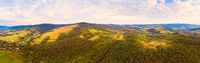 180 degrees panoramic landscape of countryside, aerial drone view of nature in Carpathians. Sunset time, end of summer