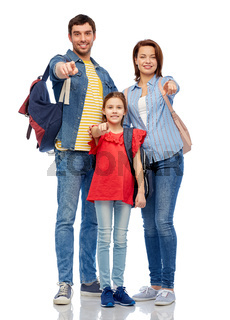 happy family with backpacks pointing finger to you