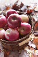 Red apples in wooden basket