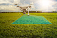 multicopter drone scanning crops field