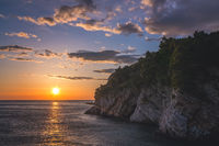 Sunset over the cliffs in Petrovac