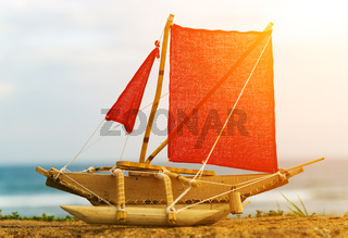 Square red sail fishing boat