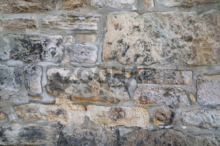 old weathered natural stone wall background texture