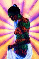 Girl with creative UV bodyart rearview