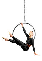 Young woman doing gymnastic exercises on the hoop isolated