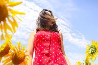 Pretty brunette woman in sunflower field