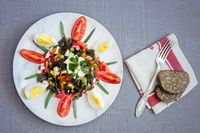 Seaweed salad kelp with egg and vegetables