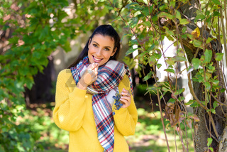 A beautiful woman eating wine grapes on a field