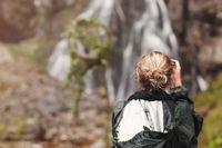 Woman tourist or photographer taking photo