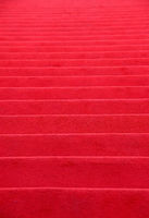 Red carpet covered stairs perspective