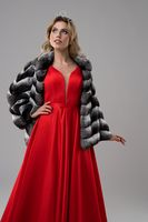 Woman in red dress and fur-coat cropped shot