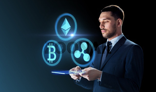 businessman with tablet pc and cryptocurrency
