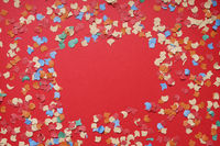 confetti frame on red paper background