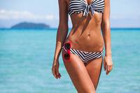 Woman body in bikini and sunglasses