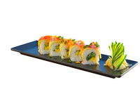 Vegetarian sushi roll with mango, cucumber, parsley.